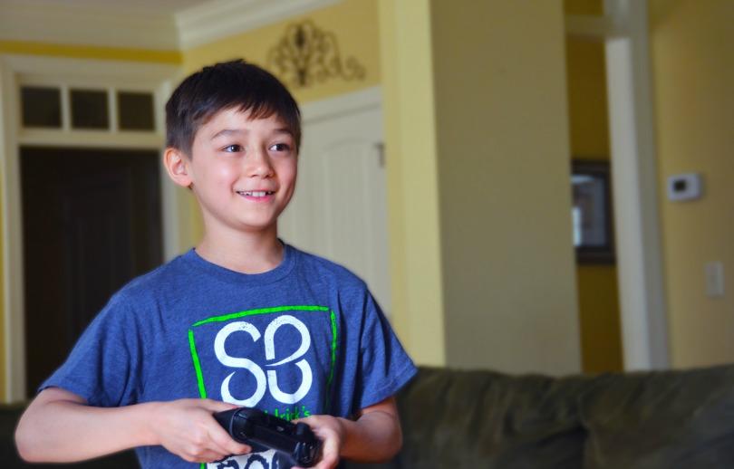 Honored Kid Scott plays video games
