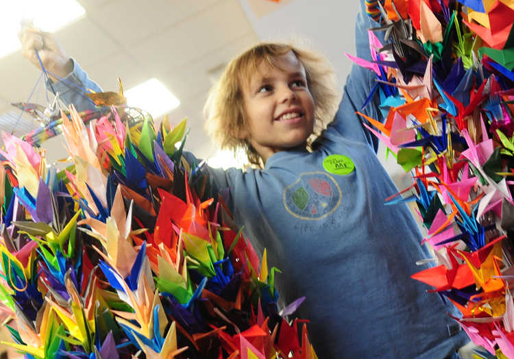 David with origami cranes