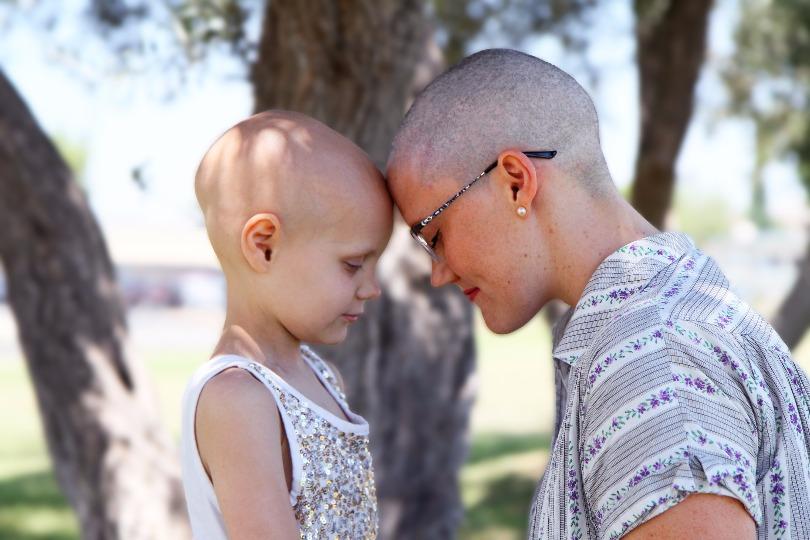 Hazel and her mom, Lauren, show off their bald heads