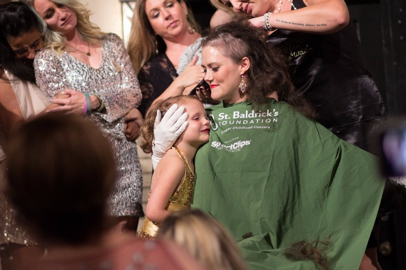 Lauren holds Hazel as she shaves her head at the 2016 Ever After Ball