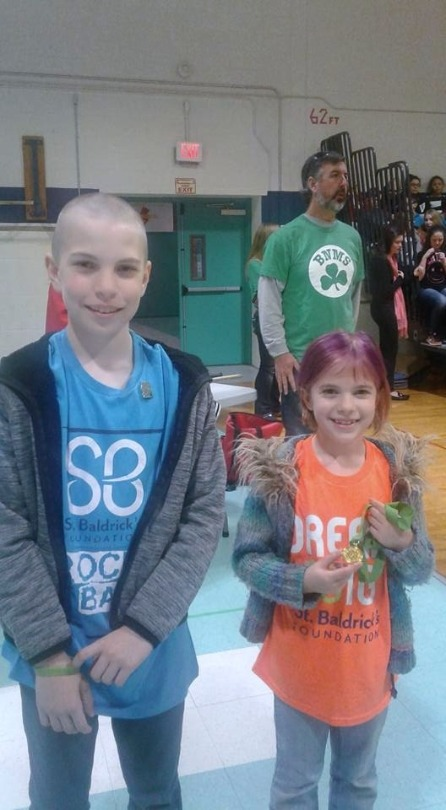 Hunter with his sister during their 2017 shave