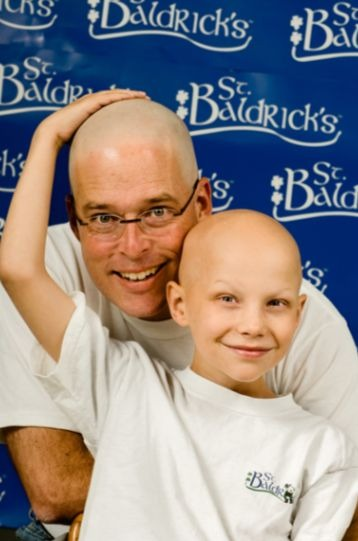 Joey and his dad, Chuck, show off their bald heads