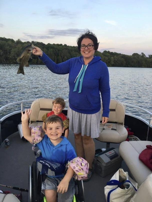 Kellan, his brother and his mom fish
