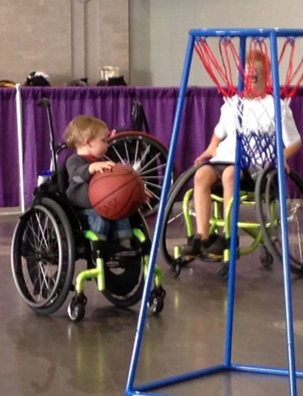 Kellan playing wheelchair basketball