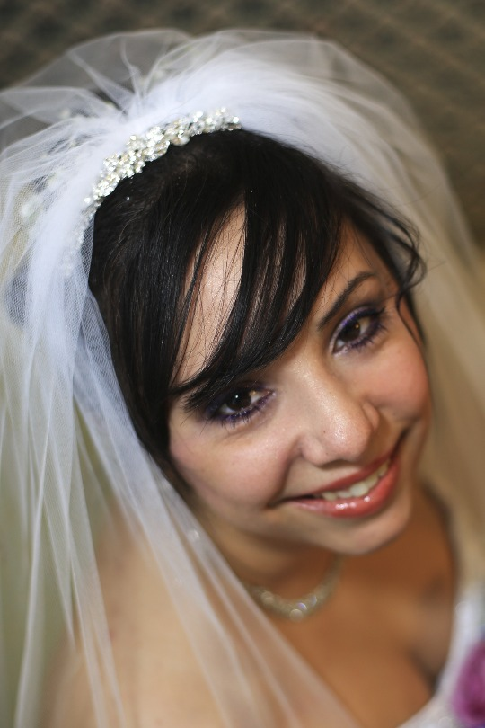 Brittany smiles during her wedding day