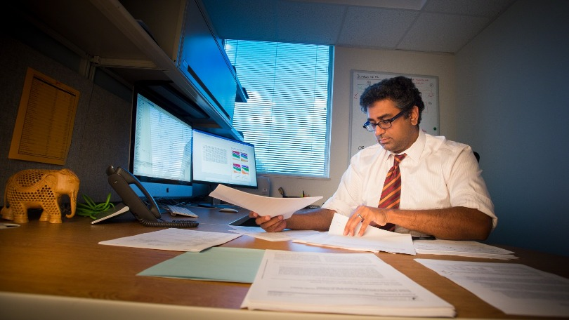 Dr. Nickhill Bhakta at his desk