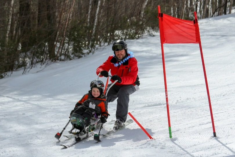 Dan guides Kellan on the ski slope