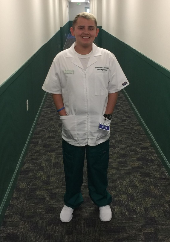 Tyler in his nursing uniform