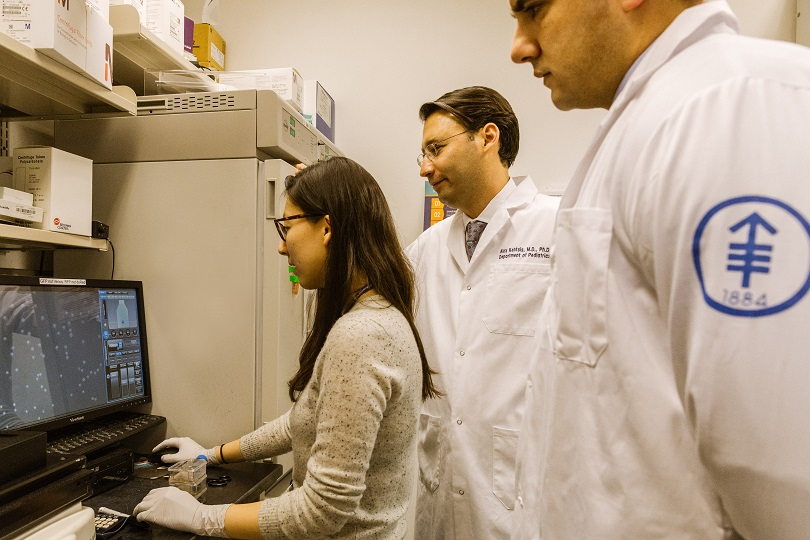 Dr. Alex Kentsis in the lab with his colleagues