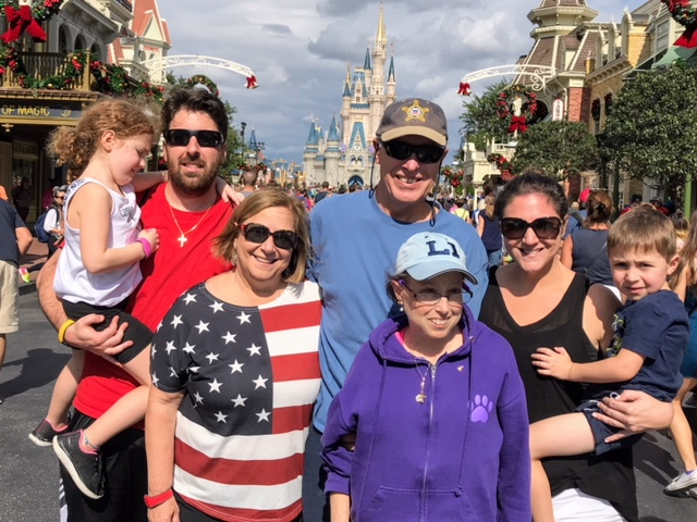 Melissa with her family at Disney