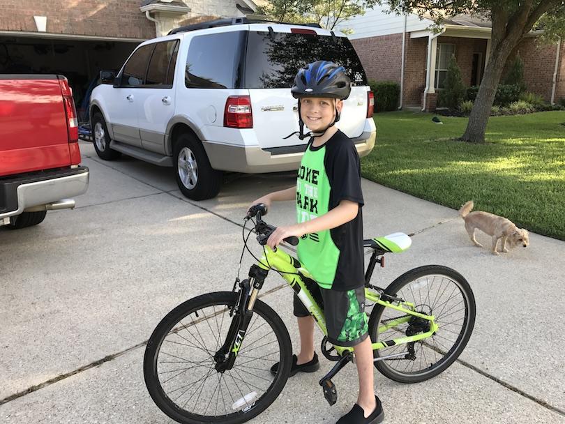Honored Kid Sullivan rides his bike