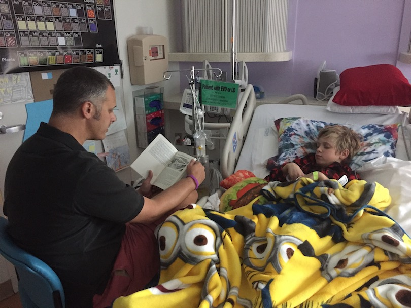 Dan reads to Sullivan during his treatment