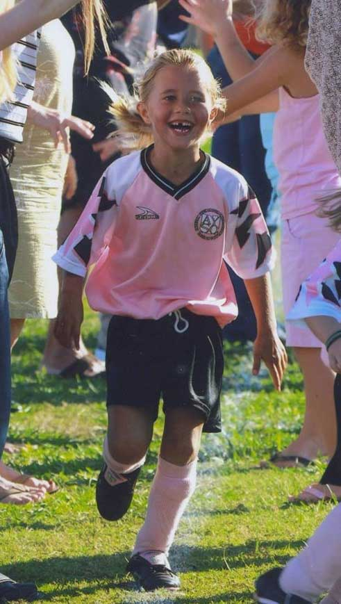 McKenna playing soccer
