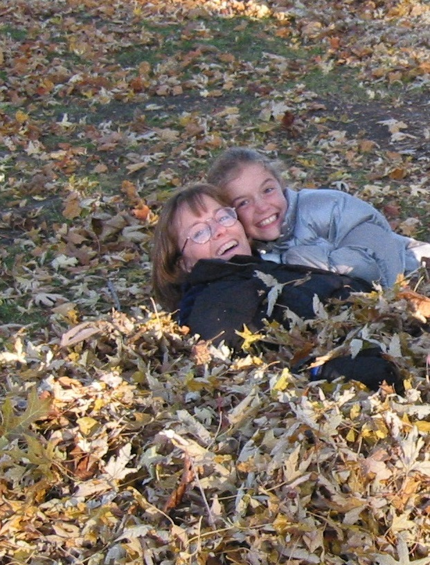 Jessica and her mom in a pile of leaves